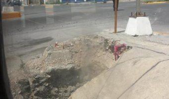 Reporte de bache en L.E.A. y Bulevar Miguel Hidalgo